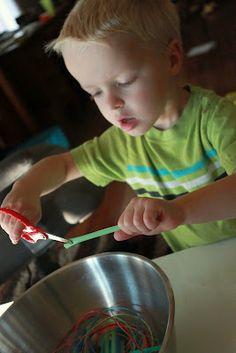 Scissor skills practice by cutting straws.