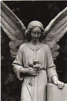 Cemetery angel by Rachelous, via Flickr