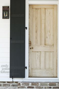 outside window shutters, the doors, exterior door shutters, black doors, black brick exterior