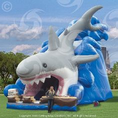 Transform your shark party with a GIANT inflatable shark slide.