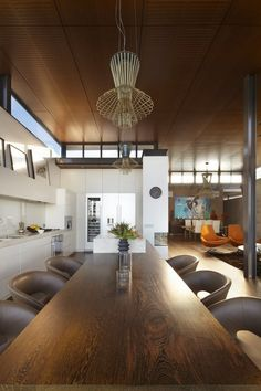 Integrated long dining table into kitchen bench.   Bronte House by Rolf Ockert Design