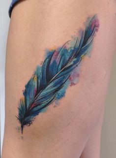 Loving this watercolor feather tattoo. Could use scar on leg as middle of feather. Sweet!