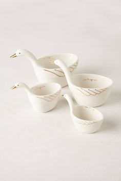 gold-trimmed ceramic geese measuring cups