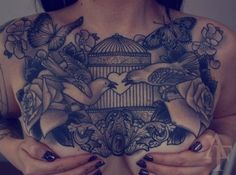cleavage bird cage love tattoo