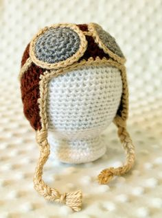 Newborn Aviator Hat Crochet Pattern via Hopeful Honey.  There are some other cute patterns at this link as well.