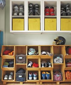 Keep open shelving organized with fabric bins. In this family's mudroom they hold off-season essentials.