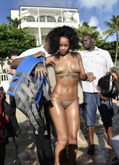 Rihanna showed off her bikini body before a little Jet Ski fun during her Barbados Christmas getaway.