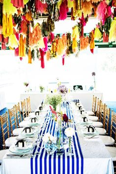 Eye-catching colorful tassels hanging over the reception table. Source: The Wedding Scoop Blog #weddingtassels $tassels tassel hang, color tassel