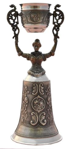 Description: The bridal cup also known as a wedding cup or maiden cup dates back centuries ago (1450) to the little town of Nuernberg in the Southern part of Germany and is a popular German wedding tradition. The swiveling cup and hollow dress were designed to allow both bride and groom to drink simultaneously to toast their wedding.