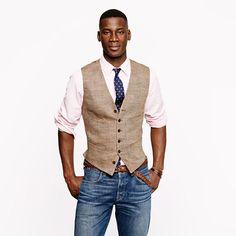 Herringbone vest, button down shirt, jeans.