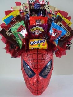 """I don't know about all of these food basket ideas (though, they'd be cheap if you purchased at the Dollar Tree).  I like the Spidey """"Mask"""" basket and would probably do a bouquet of Marvel stuff or something instead."""