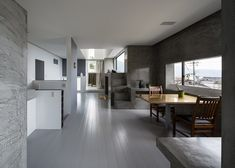 Interior shot of a Japanese house featuring a collection of differently sized cuboids that make up its volume.