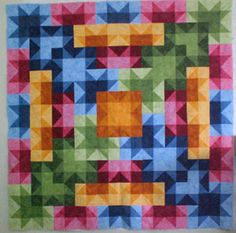 This quilt by Karen Combs just glows. Another case of having a bit of yellow/gold to make the other colors sing.