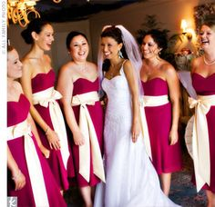 Magenta/Raspberry with silver or gray    One of the first wedding details Maliena picked out were the raspberry tea-length gowns with cream-colored sashes for her bridesmaids. Each attendant also wore a silver, garnet and pink cherry blossom bracelet during the ceremony.