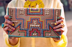 Clutch made of burlap...simple running stitch embroidery and studs embellishing