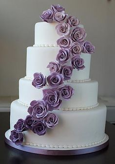 White Wedding Cake With Purple Roses - Simple yet still fun and elegant  Can we use silk flowers instead of sugar. mixed with both dark and light purple