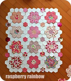 Love this Hexagon Quilt like the setting-floating an extra hexie in backround