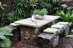 Recycled building materials can make great furniture and garden features.  Love gab ion...