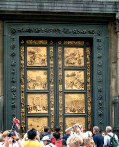 LORENZO GHIBERTI. Gates of Paradise. baptistery of Florence Cathedral, Florence, Italy, 1425-1452. Gilded bronze relief, 17' high. Early Renaissance.    Ghiberti beat Brunelleschi in the contest for the design of these doors and supposedly caused him to quit and turn to architecture. Thankfully Ghiberti won, otherwise Brunelleschi might not have designed the amazing dome