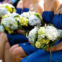 Love the white green and blue hydrangeas against the royal/cobalt blue dresses.