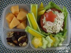 Mommy's lunch:  chicken salad stuffed tomato with cucumbers and yellow peppers, cantaloupe, and trail mix