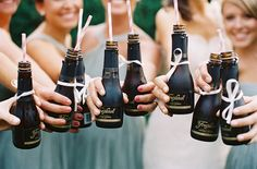 mini champagne bottles with bows! | Gabe Aceves #wedding