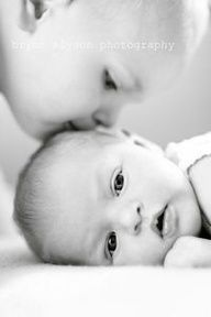 Cute sibling picture - Precious.....reminds me of my two sons :) :) :) :)