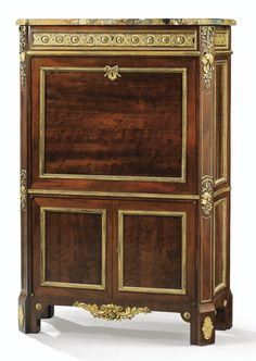 A GILT BRONZE MOUNTED MAHOGANY-SECRETARY IN LOUIS XVI STYLE SEAT, CIRCA 1850, INCLUDING 18TH CENTURY ELEMENTS