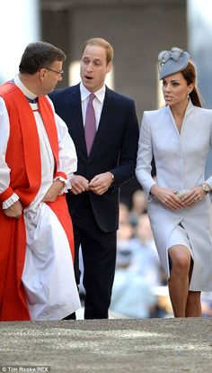 Kate's hair was pulled back in an elegant half-up style, underneath her grey hat