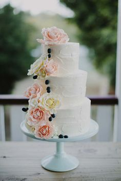 Pretty Pastel Yellow & Pink Cascading Floral Wedding Cake