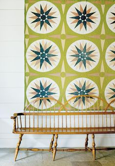 quilt and antique bench
