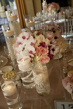 lace and ribbon wrapped floating candle holders. love the height and texture!