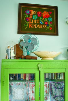 try a little kindness crewel  happygovintage apartment tour  vintage green cabinet  vintage industrial fan