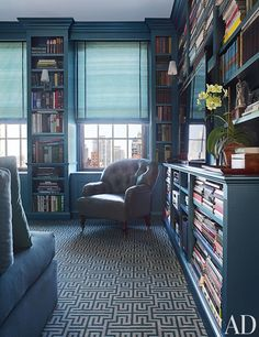 Blue library -- Designer: Vicente Wolf Associates, Inc. -- Photographer: Pieter Estersohn -- Architectural Digest