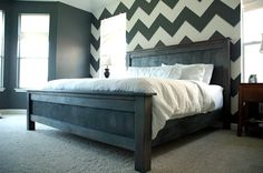 LOVE the grey walls and that Chevron accent wall...and the white bedding!