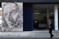 Vhils in London in 2012 (Photo courtesy of CARL COURT/AFP/Getty Images)