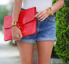 Hermes cuff envy and denim street style with red clutch bag