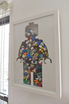 Wonderful shadow box cut-out filled with minfigs... Might be an idea when and if he ever stops playing with them...