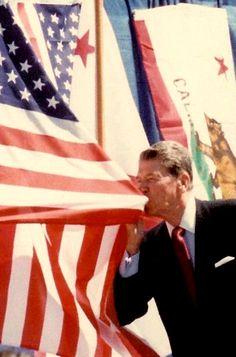 President Reagan kissing the American flag.