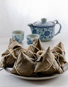 Sticky Rice Dumplings wrapped in bamboo leaves in China can be served savory (filled with meat) ,sweet (with palm syrup/coconut jam)