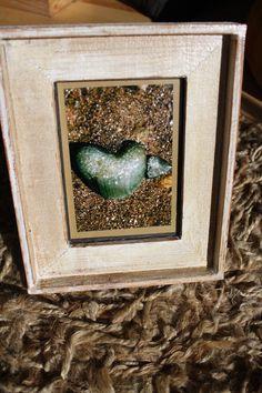 Framed heart shaped rocks photograph.
