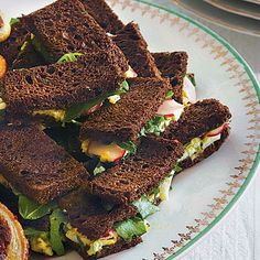 Pumpernickel Tea Sandwiches | Smear a bit of herb-flavored egg salad on these dainty sandwiches and top them with arugula and radishes. | SouthernLiving.com