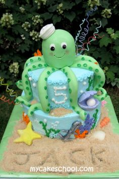 Octopus cake...click on the photo and it teaches you how to make these cute cakes!