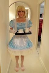 Sissy Maid in blue satin and lace serving afternoon tea