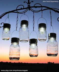 These mason jar lanterns add the perfect soft lighting to a garden wedding. Jars available for purchase at www.freshpreservingstore.com.