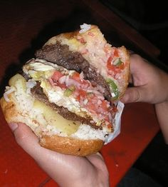 Bolivian street food - Trancapecho. yum (Bread, fried potato slices, meat, fried egg, rice, more meat, tomatoes onions etc.)