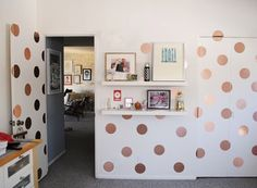 Polka dots walls made from metallic contact paper, such a great idea!