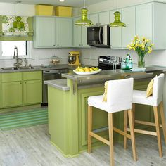Love the apple green color! Cabinetry Makeover  Give outdated cabinetry a new lease on life with paint, your simplest and most affordable tool in a small kitchen update. Sanded, primed, and painted, the cabinets in this kitchen now gleam apple green on base cabinets and soft teal on upper wall cabinets. Appliances and storage bins in yellow add a citrus pop to the kitchen.