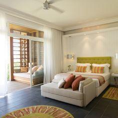 Long Beach Mauritius. Keith Interior Design - love the green tufted headboard