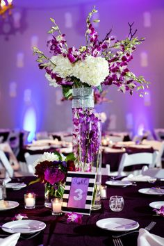 Purple, black and white wedding table floral center pieces Sherri J Photography I The SnapKnot Blog
